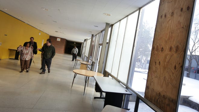 Members of the American Federation of Teachers tour Osborn Collegiate Academy of Mathematics Science and Technology looking at some of the poor conditions that have prompted sickouts in DPS in Detroit on Thursday, Jan. 14, 2016.