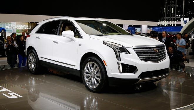 The 2017 Cadillac XT5 is on display during the Los Angeles Auto Show Thursday, Nov. 19, 2015, in Los Angeles.
