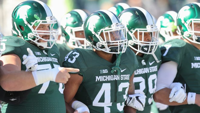 Michigan State Spartans take the field before the game against the BYU Cougars on Saturday, October 8, 2016 at Spartan Stadium in East Lansing.