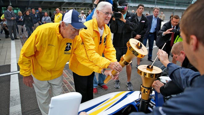 Ted Boehm and Sandy Knapp hold the Bicentennial Torch at   Indianapolis Motor Speedway on Saturday, Oct. 15, 2016, to transfer the flame to another torch in an IndyCar two-seater that former IndyCar Series driver and owner  Sarah Fisher drove, torch in the back seat, around the track two laps.  The torch started the last leg of the statewide tour at   IMS, to end the route at the Statehouse with a big homecoming celebration.