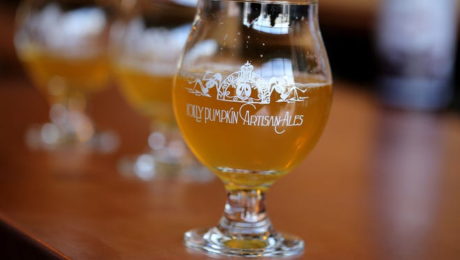 A Jolly Pumpkin goblet contains Saison Ale at Jolly Pumpkin Artisan Ales, Pizzeria and Brew Pub on Thursday, March 5, 2015.