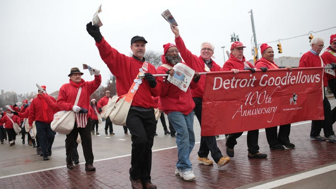 Members of the Detroit Goodfellows march along Woodward Ave. in Detroit during the 90th America's Thanksgiving Parade in Detroit on Thursday, Nov. 24, 2016.