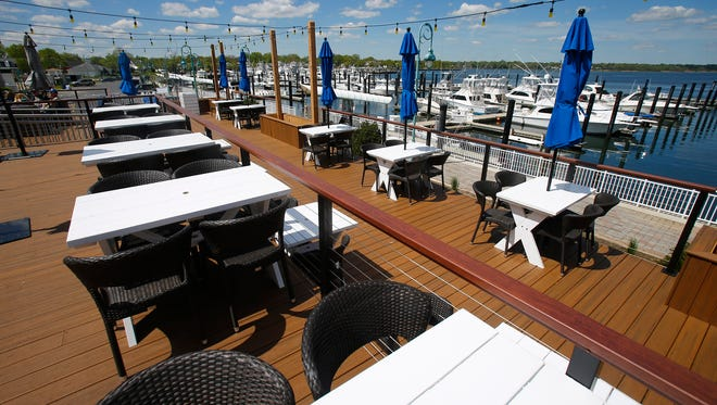 An outdoor seating area is shown at the recently opened Marina Grille Tuesday, May 9, 2017, along the Shark River in Belmar.