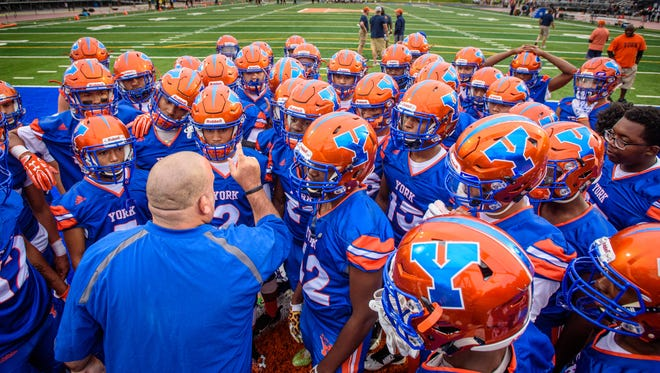York High head coach Russ Stoner fires up players after warmups before a game against Reading on Friday, Sept. 1, 2017.