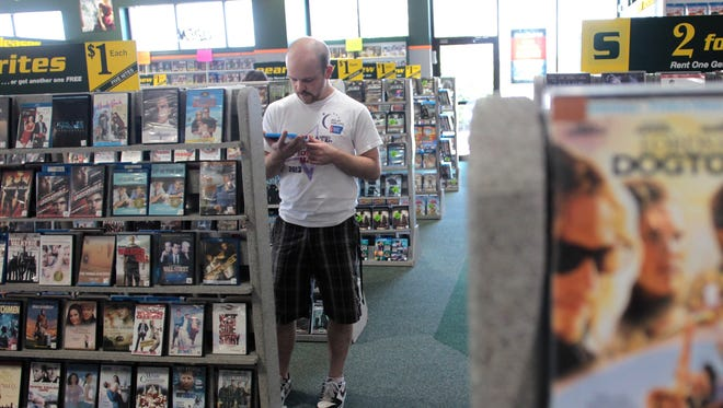 A customer browses for movies at the Iowa City Family Video at 101 Highway 1 W. in this Press-Citizen file photo.