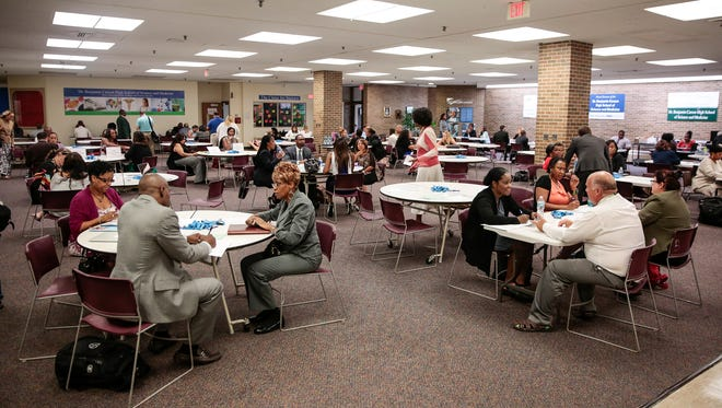 The Detroit Public Schools Community District, in an effort to address teacher vacancies, holds a job fair at the Dr. Benjamin Carson High School of Science and Medicine in Detroit in August 2017.