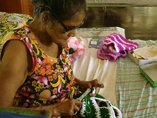 A patient knitting at Hendala Leprosy Hospital in Sri