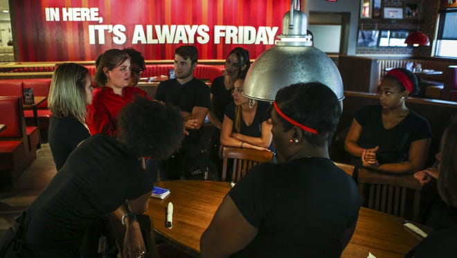 Front of house staff hold a meeting before beginning their mock session Thursday afternoon at the new TGI Fridays in the Stone Creek Towne Center.