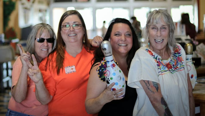 One of nine teams that competed in the Bowling for Fur Balls Cinco de Mayor No-Tap Tournament .