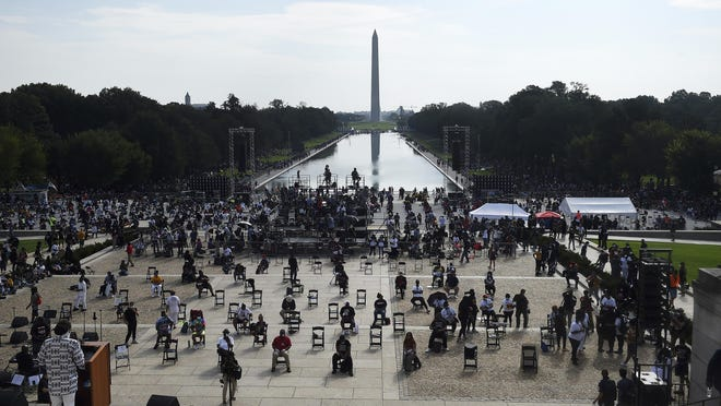 """Demonstrators gather at the Lincoln Memorial as final preparations are made for the March on Washington, Friday Aug. 28, 2020, at the Lincoln Memorial in Washington, on the 57th anniversary of the Rev. Martin Luther King Jr.'s """"I Have A Dream"""" speech."""