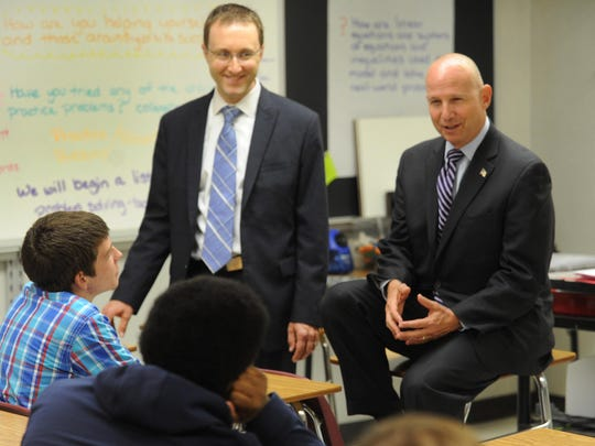 Gov. Jack Markell (right) and State Secretary of Education Mark Murphy talk with students at Laurel High School on Sept. 23. Murphy is stepping down from the position.