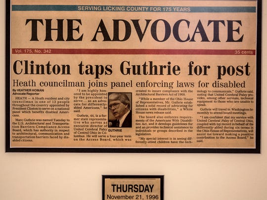 Newspaper articles hang in Marc Guthrie's home office