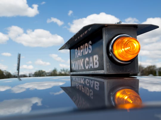 Rapids Kwik Cab sign on one of the taxi cabs in Wisconsin Rapids, Monday, May 2, 2016.