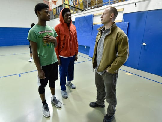 FBI Special Agent Justin Downen, right, with the Green Beret Project, talks with DeMarius Lee, 14, left, and Juan Jordan, 14, at Fort A.B.L.E. in Dover.