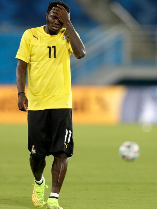 Ghana's Sulley Muntari walks on the pitch during an official training session the day before the group G World Cup soccer match between Ghana and the United States at the Arena das Dunas in Natal, Brazil, Sunday, June 15, 2014. (AP Photo/Dolores Ochoa)