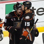 Anaheim Ducks right wing Teemu Selanne, of Finland,, left, gets a hug from center Ryan Getzlaf after they were defeated by the Los Angeles Kings in Game 7 of an NHL hockey second-round Stanley Cup playoff series.