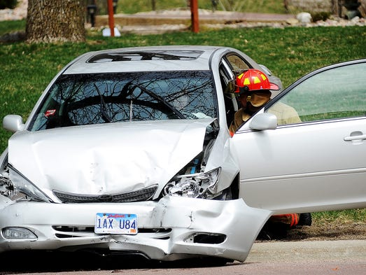 Sioux Falls Fire and Rescue and Sioux Falls Police Department work the scene of an accident on Wednesday, April 23, 2014, at the intersection of 57th Street and Tomar Road. (Joe Ahlquist / Argus Leader)