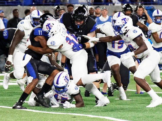 Tennessee State linebacker Chris Collins (32) tackles