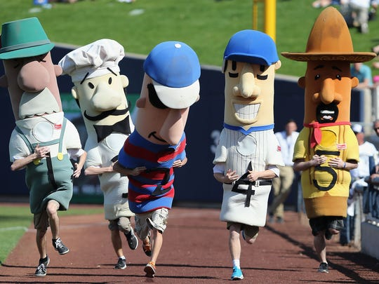 The Sausage Race mascots compete during the spring training game between the San Diego Padres and Milwaukee Brewers at Maryvale Baseball Park on March 7, 2014 in Phoenix, Arizona.