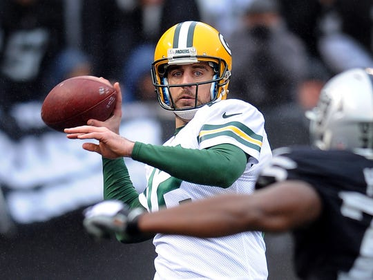 Green Bay Packers quarterback (12) Aaron Rodgers back to pass during a game against the Oakland Raiders played at O.co Coliseum in Oakland on Sunday, December 20, 2015. (AP Photo/John Cordes)