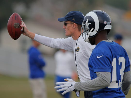 John Fassel gives some pointers to wide receiver Mike Thomas during practice Monday. Fassel will try to help the Rams finish a bad season in a positive manner as interim head coach for the final three games.