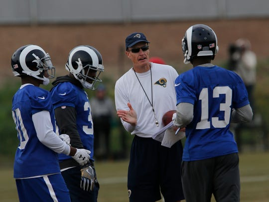 Interim head coachJohn Fassel talks with wide receiver Mike Thomas (13) and his teammates during Rams practice on Monday.