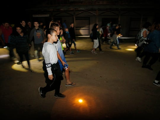 "Using flashlights, Shanti Lanes, Oliver Previde, Luke Andrade and other guests explore the historic Paramount Ranch in Agoura Hills during the National Park Service's new nighttime program called ""The Ghosts of Paramount's Past."""