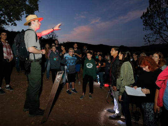 """At one of the stops during the National Park Service's new nighttime program called """"The Ghosts of Paramount's Past,"""" park guide Scott Sharaga shares some of the more eerie stories about the movie ranch."""