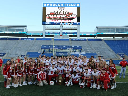 The Beechwood Tigers pose with the championship trophy