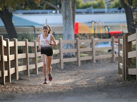 Oak Park High junior Sylvia Cruz-Albrecht runs on one