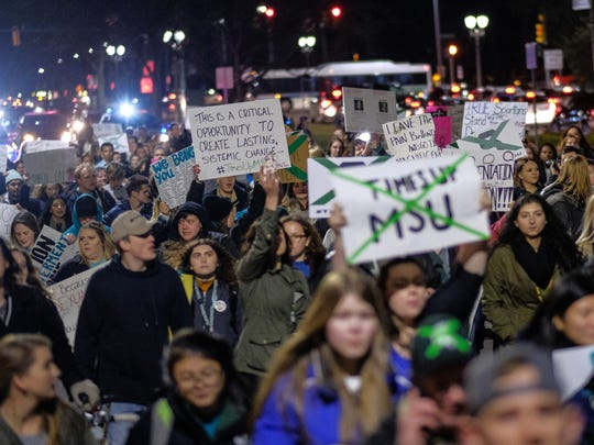 People march along Grand River in East Lansing on Friday, January 26, 2018 on the Michigan State University campus in East Lansing while speaking out against sexual assault following the Larry Nassar case.
