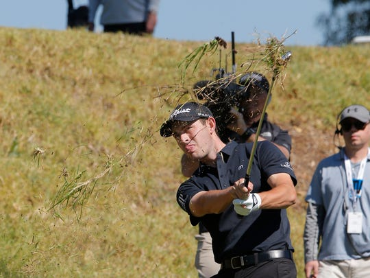 Patrick Cantlay hits out of the deep rough on the fifth hole during the third round of the Genesis Open at Pacific Palisades on Saturday. Cantlay is one shot back of Bubba Watson heading into the final round.