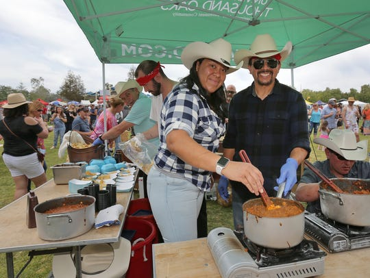 Patti Depaz and Santos Rodriguez, from the University Village of Thousand Oaks booth, prepare some of their homemade bison and smoked short rib chili during the 2018 Thousand Oaks Rotary Chili Cook-off and Craft Beer Festival.