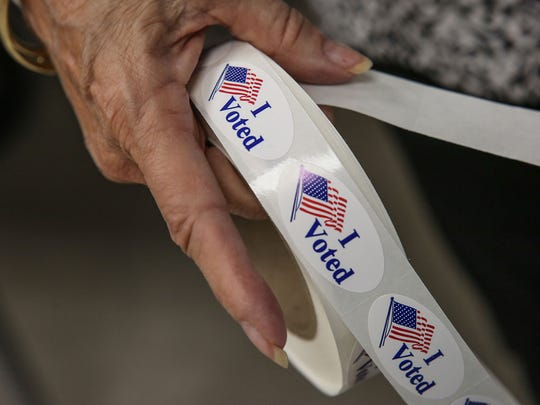 Stickers are given out to voters at the James O. Jessie Desert Highland Unity Center in Palm Springs, June 5, 2018.