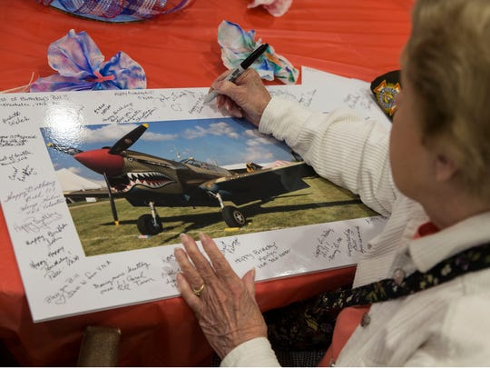 World War II veteran and Flying Tiger Bill Laun of Manchester, is honored with a party for turning 107 years old. Friends sign a photo of a P-40 airplane, those used by the Flying Tigers. Manchester, NJFriday, June 8, 2018@dhoodhood