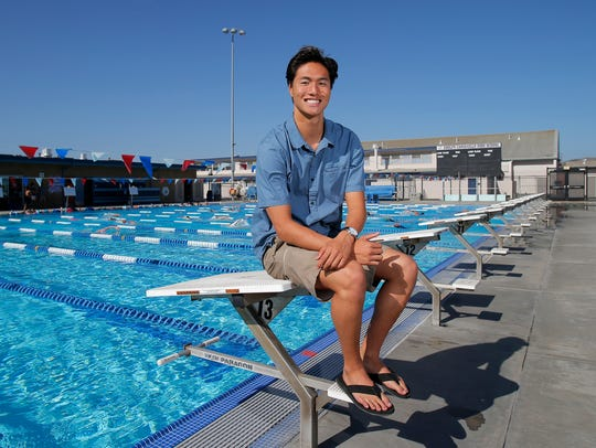 Jason Lu, posing at the Camarillo High pool where he