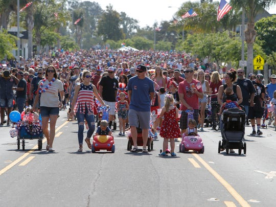 Participants walk down Main Street in Ventura during the Rotary Club of Ventura East's 43rd annual Push 'em Pull 'em Parade.