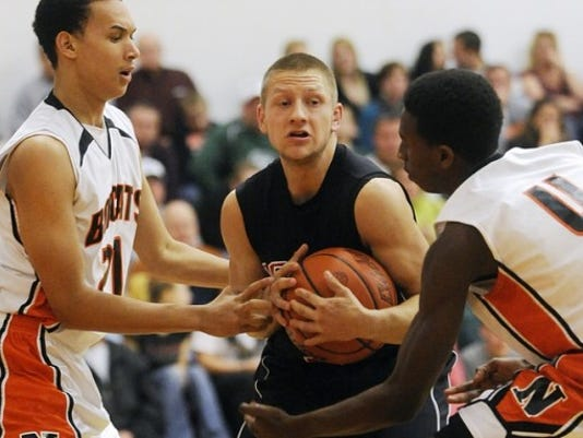 Dover Brandon Smith (center) helped lead the Eagles past Northeastern on Tuesday.