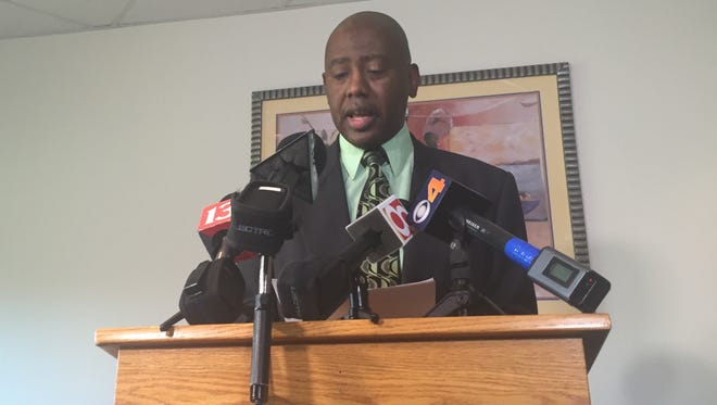 Rev. Charles Harrison speaks to the media about recommendations for improving police-community relations.