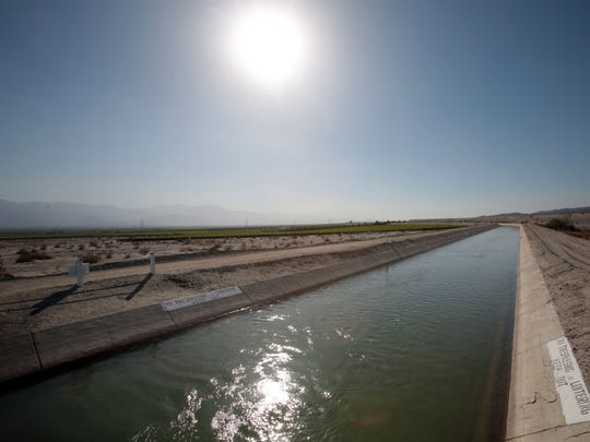 In this 2014 photo, the Coachella branch of the All-American Canal passes through the desert in Mecca, California.