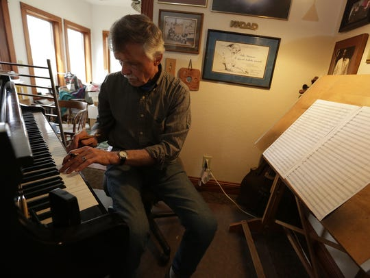 John Harmon composes a piece at his home in Winneconne.