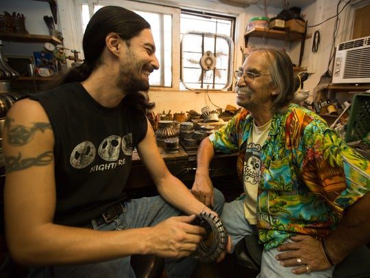 Artist Peter Van Tongeren, right, shares a laugh with his son Zach Van Tongeren inside their Las Cruces shop where they create handcrafted chandeliers out of tin.