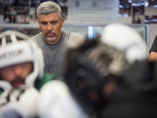 Joel Diaz keeps an eye on his fighter during a sparring session.