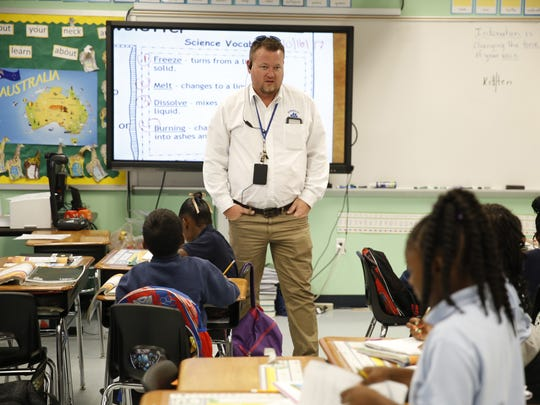 Jefferson County K-12 Principal Cory Oliver visits a second grade classroom Oct 16.