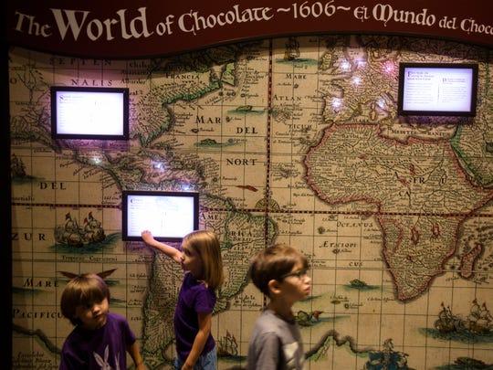 Mary McCosham, 5, explore's Chocolate: The Exhibition
