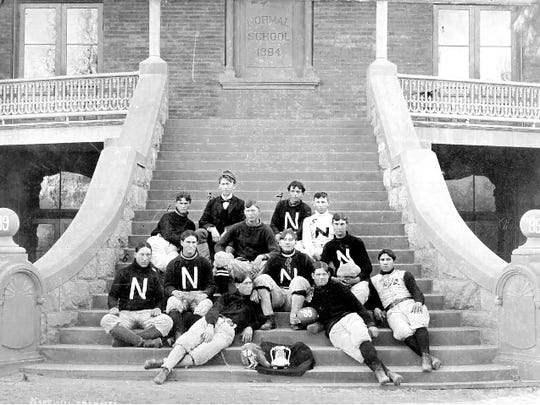 A photo of the 1899 Territorial Normal School At Tempe football team with their championship trophy. This photo was originally thought to have been taken on Thanksgiving 1899 following the Tempe school's victory against the University of Arizona. New research shows it was taken in January 1900. Photo courtesy: ASU Archives