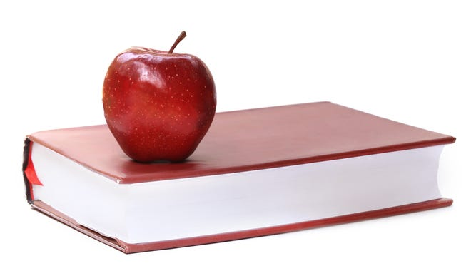 Apples, books - and low salaries for Florida teachers.