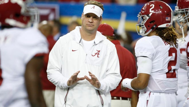 Alabama offensive coordinator Lane Kiffin speaks with quarterback Jalen Hurts prior to the SEC championship game against Florida.
