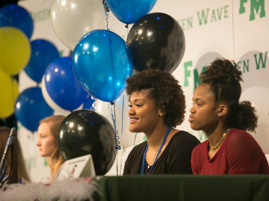 Alexsis Johnson, center, of Fort Myers High School