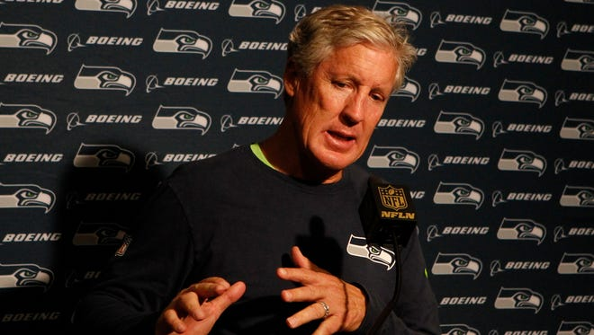 Seattle Seahawks head coach Pete Carroll speaks to the media after an NFL football game against the Cincinnati Bengals, Sunday, Oct. 11, 2015, in Cincinnati. The Bengals won 27-24.